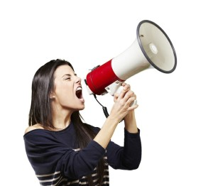 bigstock-young-woman-shouting-with-a-me-330458091-300x262